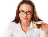 Businesswoman drinking green tea — Stock Photo