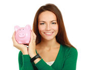 Woman standing with piggy bank (money box) — Stock Photo