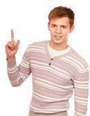 Young man pointing at something — Stock Photo