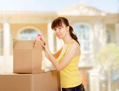 Woman with box moving — Foto de Stock