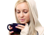 Smiling female holding a coffee — Foto Stock