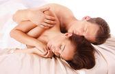 Heterosexual couple on the bed — Stock Photo