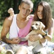 Young couple with a puppy — Stock Photo