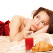 Woman having breakfast in bed — Stock Photo