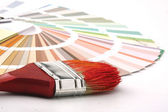 Paintbrush and a colorful paint — Stock Photo