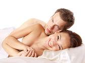 Nude heterosexual couple on the bed — Stock Photo