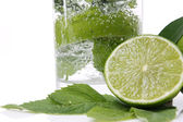 Mint and lime in a glass — Stock Photo