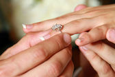 Man putting a ring on his woman's finger — Stock Photo