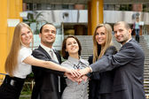 Business partners hands on top of each — Stock Photo