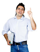 Man with books pointing up — Stock Photo