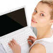A young woman with a laptop. — Stock Photo #43127047
