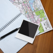 Notebook, pen, photo, map on the desk. — Stock Photo