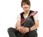 Ein schöner mann, eine gitarre zu spielen — Stockfoto