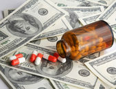 Pills and money. — Stock Photo