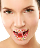 Woman lips with multicolored pearls. — Stock Photo