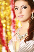 Young brunette woman with champagne — Stock Photo