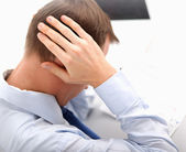 A businessman with a headache — Stockfoto