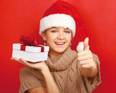 Woman with christmas gifts and showing ok — Stock Photo