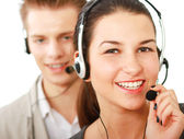 Young people working in a call center — Stock Photo