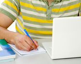 Guy in front of a laptop studying — Stock Photo