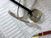 Stethoscope on the cardiogram. — Stock Photo