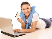 Woman with a laptop and a credit card — Stock Photo