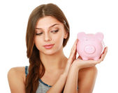 Woman standing with piggy bank — Stok fotoğraf