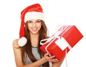 Christmas woman holding gift wearing Santa hat. — Stock Photo