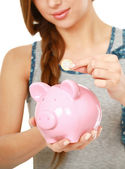Woman standing with piggy bank — Photo
