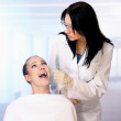 Female patient takes a dental attendance — Stock Photo #43175623