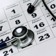 Stethoscope on calendar — Stock Photo