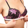 Young woman measures her breast — Stock Photo #43179135