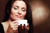 Woman with an aromatic coffee in hands — Stock Photo