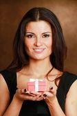 Female hand holding gift box — Stock Photo