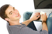 Guy sitting on the floor with a laptop — Stock Photo