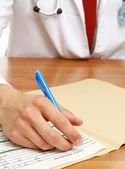 Hands of a doctor filling RX prescription — Foto Stock