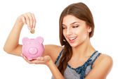 Woman standing with piggy bank — Stockfoto