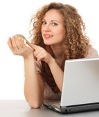 Woman holding a glass globe  with laptop — Stock Photo