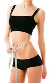 Slim waist with a tape measure around it — Stock Photo