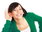 Joven mujer escuchando — Foto de Stock
