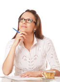 Businesswoman thinking with a cup of tea — Stock Photo