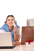 Woman  with a laptop and credit card — Stock Photo