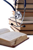 Medical education with book and stethoscope — Stock Photo