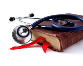 Stethoscope on a book with a red bookmark — Stockfoto