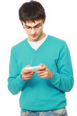 Man met behulp van een mobiele telefoon — Stockfoto
