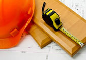 Tape measure and helmet — Stock Photo
