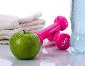 Towel, water, apple, dumbells — Stock Photo
