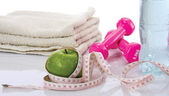 Towel, water, apple, tape,dumbells — Stock Photo