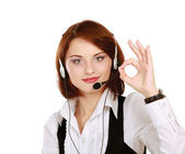 Woman with headset showing OK — Stock Photo