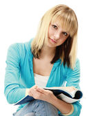 Girl with a pen and a textbook — Stock Photo